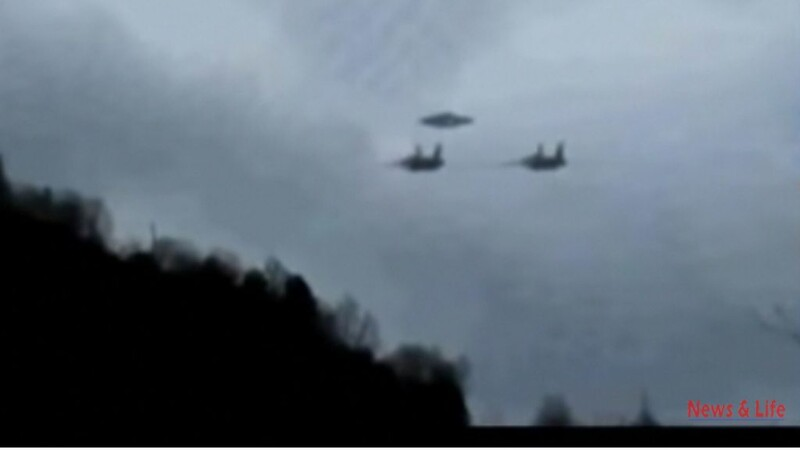2 Military Helicopters Escorting A Flying Disk in What Looks Like A Real Video 2