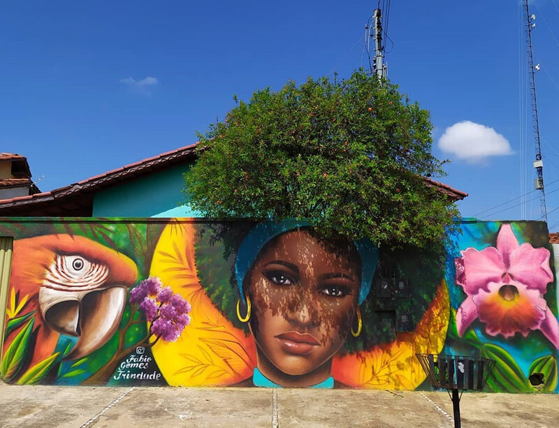 This brazilian street artist used real trees to complete these portraits of women 4
