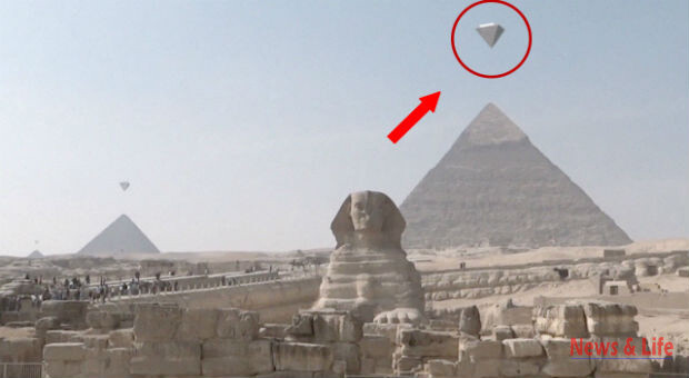 A STUNNING video which appears to show three crystal clear UFOs hovering over the ancient pyramids of Giza has gone viral 3