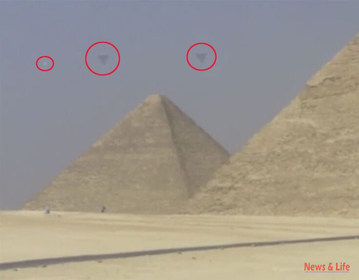 A STUNNING video which appears to show three crystal clear UFOs hovering over the ancient pyramids of Giza has gone viral 2